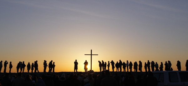The sun rises as people gather for an ecumenical Easter service in Scituate, Mass., March 31. (CNS photo/Jessica Rinaldi, Reuters) (April 1, 2013)
